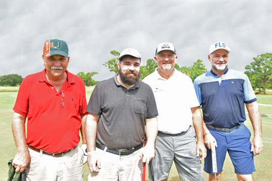 Doug Allard, left, Chris Allard, Ken Duke and Ronnie Dechambeau played in the Dolphin Bar & Shrimp House Golf Tournament Fundraiser for Treasure Coast Food Bank.