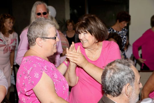 Breast cancer survivors Michelle Bazin, left, and Kathy Aul at the Friends In Pink Luncheon on Oct. 26, 2019, at the St. Lucie Trail Golf Club in Port St. Lucie.
