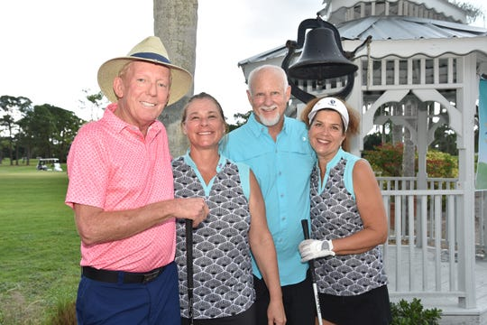 Jack Hodge, left, Gretchen Steele, Roger Horn and Kat Chandler played in the Dolphin Bar & Shrimp House Golf Tournament Fundraiser for Treasure Coast Food Bank.
