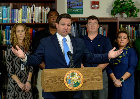 "Florida Gov. Ron DeSantis makes a statement on raising teacher and principal salaries while standing with staff of Vero Beach High School inside the school's library on Thursday, Nov. 14, 2019, in Vero Beach. ""Richard [Cocoran] and I just decided, 'Let's just do a strong bonus program for not only teachers, but for principals,' and we're proposing to do that at the tune of $300-million dollars, which is more than they've ever done for bonuses before in the state of Florida,"" DeSantis said."