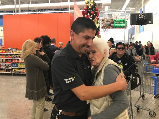"Emma Gandara, embraces Walmart store manager Robert Evans. She was a regular customer as was her good friend, 86-year-old Angelina ""Angie"" Silva-Englisbee, who was the second-eldest victim of a mass shooting on Aug. 3, 2019."