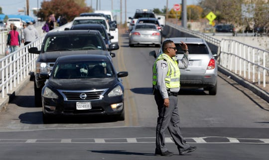 A Sheriff's Deputy directs traffic at the east side El Paso Walmart during its reopening Thursday.