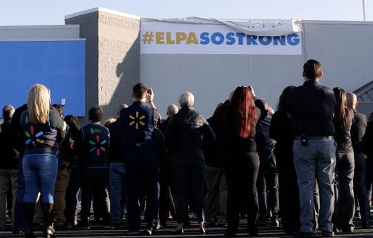 El Paso Walmart employees gather outside the store Thursday, November, 14, 2019 as they unveil an #ELPASOSTRONG banner on the side of the building just before their grand reopening. The Walmart in El Paso, Texas was the site of a mass murder which killed 22 and wounded another 25 on Aug. 3, 2019.