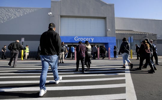 Walmart customers enter the store after it reopened at 8:45 Thursday, November, 14, 2019.  The Walmart in El Paso, Texas was the site of a mass murder which killed 22 and wounded another 25 on Aug. 3, 2019.
