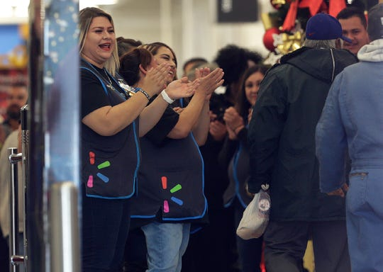 Walmart employees cheer as customers return to the store Thursday, November, 14, 2019  The Walmart in El Paso, Texas was the site of a mass murder which killed 22 and wounded another 25 on Aug. 3, 2019.