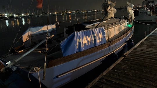 A homemade vessel named the Mayfly is moored at Channel Islands Harbor in Oxnard on Thursday after being towed in from sea. The man aboard the Mayfly started his journey at the end of May in Japan and was due to arrive in San Francisco at the end of August but was delayed by two months due to a lack of wind. He ran out of food and water more than once.