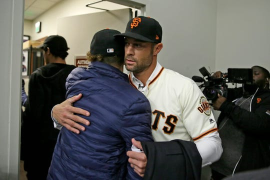 Ventura High's Dane Kapler, left, hugs his father Gabe Kapler after Gabe was introduced as the new manager of the San Francisco Giants on Wednesday in San Francisco. Dane made it back to football practice the same day.