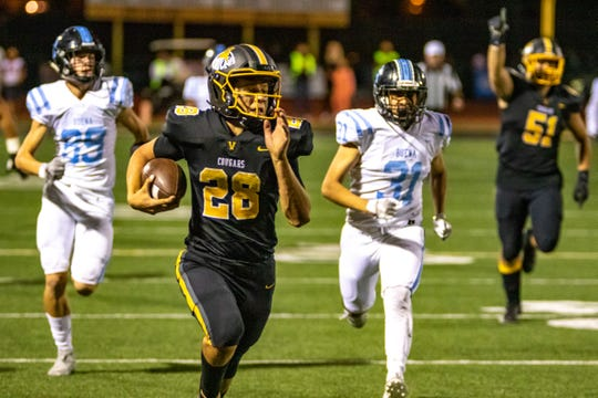 Ventura High's Dane Kapler breaks away for a 63-yard touchdown run against rival Buena on Oct. 25. After his house burned down during the Woolsey Fire, Kapler chose to transfer from Malibu High to Ventura.