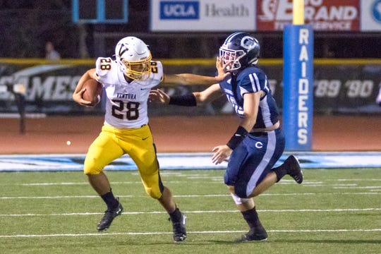 Ventura High's Dane Kapler uses a stiff-arm to keep back a defender during a game against Camarillo this season. Kapler has rushed for 914 yards in nine games for the Cougars.
