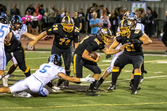 Dane Kapler tries to break free during Ventura's win over rival Buena. Kapler rushed for 174 yards and a touchdown on 13 carries.