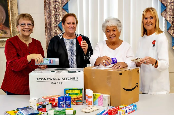 (From left) Barbara Westog, Embrella project chair, Millville Woman's Club, and club members Louise Jones, Barbara Mazza and Judy Crowe assemble items to be donated to Embrella.
