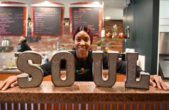 Sharonda Harris-Bunton, owner of Vegans Are Us in Vineland, prepares 100% plant-based soul food during Thursday's lunch rush.