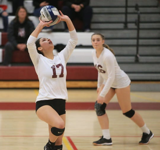 Ossining's Brianna Culcay sets the ball during the Class AA Girls Volleyball Regional Semifinal versus Pine Bush in Kingston on November 13, 2019.