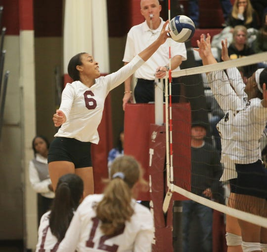 Ossining's Mychael Vernon hits the ball through Pine Bush's defenders during the Class AA Girls Volleyball Regional Semifinal in Kingston on November 13, 2019.