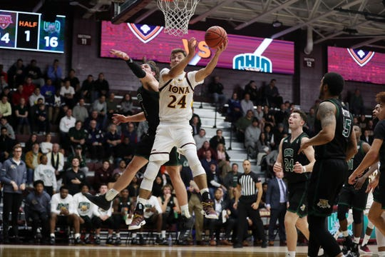 Iona's Dylan van Eyck (24) drives to the basket in front of Ohio's Ben Vander Plas (5) during college basketball action at the newly renovated Hynes Center at Iona College in New Rochelle Nov. 11, 2019.