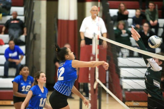 Hendrick Hudson's Caitlin Weimar spikes the ball on Cornwall's line during the Class A Girls Volleyball Regional Semifinal in Kingston on November 13, 2019.