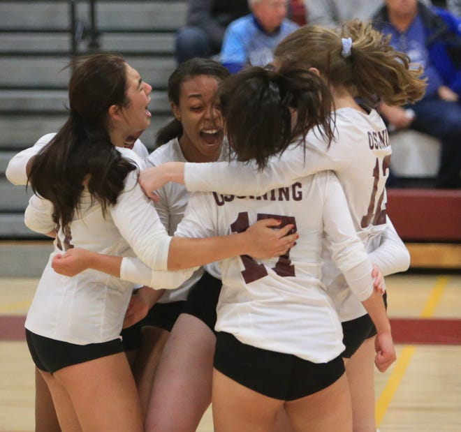 Ossining celebrates their win overt Pine Bush in the Class AA Girls Volleyball Regional Semifinal in Kingston on November 13, 2019.