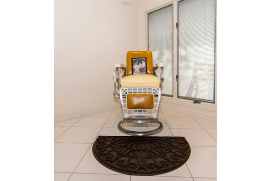This barber chair in Joe Pesci's  New Jersey shore home is a nod to the actor's first job as a barber.