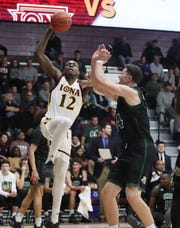 Iona's Tajuan Agee (12) drives to the basket infant of Ohio's Mason McMurray (24) during college basketball action at the newly renovated Hynes Center at Iona College in New Rochelle Nov. 11, 2019.