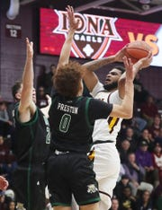Iona's E.J. Crawford (2) puts up a shot in front of Ohio's Jason Preston (0) during college basketball action at the newly renovated Hynes Center at Iona College in New Rochelle Nov. 11, 2019.
