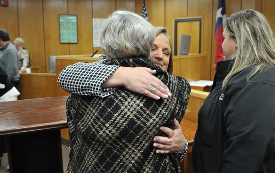 Newly sworn-in 78th District Court Judge Meredith Kennedy was greeted with hugs and well-wishes Thursday morning.