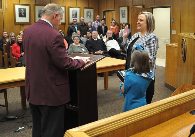 Retired 78th District Court judge Barney Fudge, left, swore in Meredith Kennedy as the new district judge Thursday morning in the 78th District courtroom. Kennedy's daughter, Jaci, stands beside her.