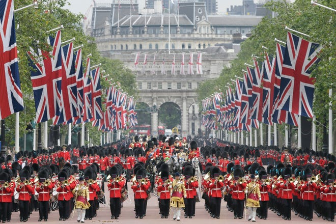 Hundreds of soldiers in ceremonial dress surround Queen Elizabeth II's royal carriage on the Mall during the annual Trooping The Colour parade in London, June 11, 2016.