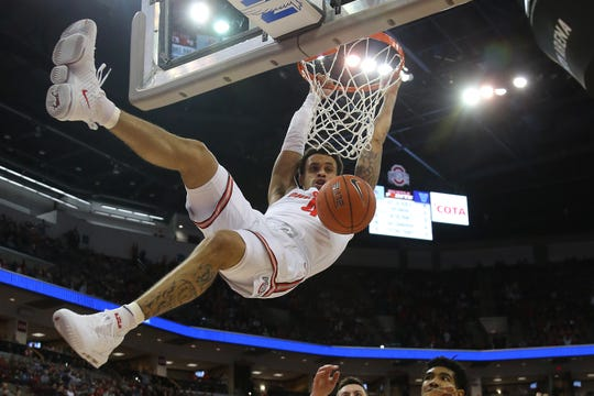 Ohio State Buckeyes guard Duane Washington Jr. dunks against the Villanova Wildcats during the first half at Value City Arena in Columbus, Ohio.