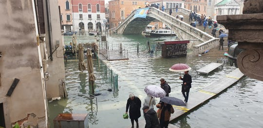 Carol Rourke and her tour group continued their tour of Venice through record-breaking floods.