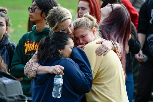 Saugus High students hug as they wait to be picked up by family members at a reunification point after a shooting at Saugus high school in Santa Clarita, Calif. on Nov 14. 2019.
