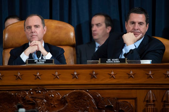 House Intelligence Committee Chairman Rep. Adam Schiff, D-Calif., left, and ranking member Rep. Devin Nunes, R-Calif., listen as they attend a hearing of the House Intelligence Committee on Capitol Hill in Washington, Wednesday, Nov. 13, 2019, during the first public impeachment hearing of President Donald Trump's efforts to tie U.S. aid for Ukraine to investigations of his political opponents.