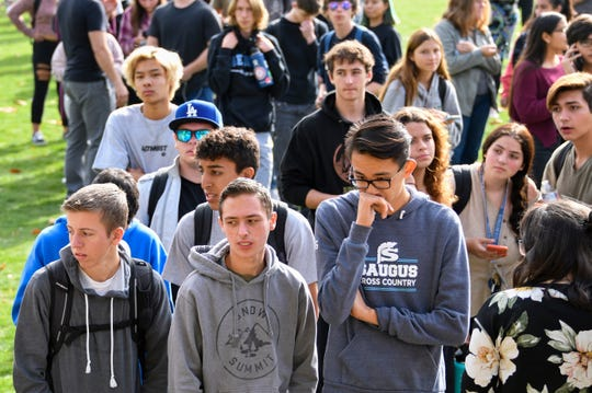 Saugus High students wait to be picked up by family members at a reunification point after a shooting at Saugus high school in Santa Clarita, Calif. on Nov 14. 2019.