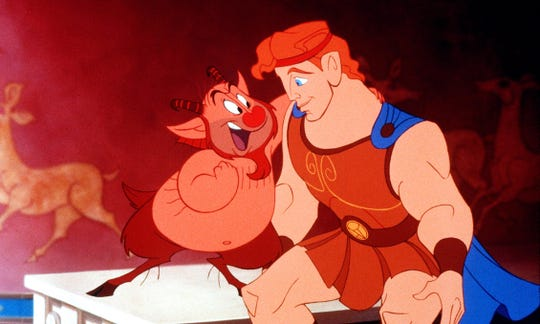 """A scene from Disney's""""Hercules"""" featuring Phil and Hercules."""