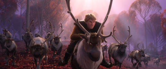 "Kristoff (voiced by Jonathan Groff) and his reindeer best friend Sven ride with the herd in ""Frozen 2."""