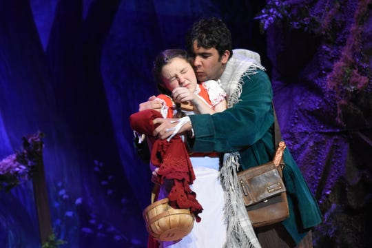 """Jenevieve Bolen (left) stars as Little Red Riding Hood and Abbas Khambatti as the Baker in the Bolton Conservatory for the Performing & Visual Arts' presentation of """"Into the Woods."""""""