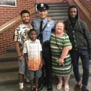 Janet Hans with sons Justin, Naeim, Joe (in uniform) and Justin and Nagid.