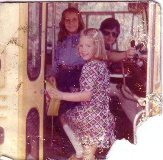 On their first day of kindergarten in Point Pleasant Borough 43 years ago, Liz Brown (center) and Debi Courtney get on the schoolbus together.