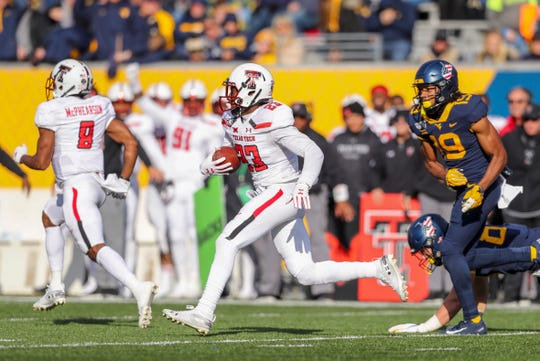 Nov 9, 2019; Morgantown, WV, USA; Texas Tech Red Raiders defensive back Damarcus Fields (23) returns an interception against the West Virginia Mountaineers during the third quarter at Mountaineer Field at Milan Puskar Stadium. Mandatory Credit: Ben Queen-USA TODAY Sports