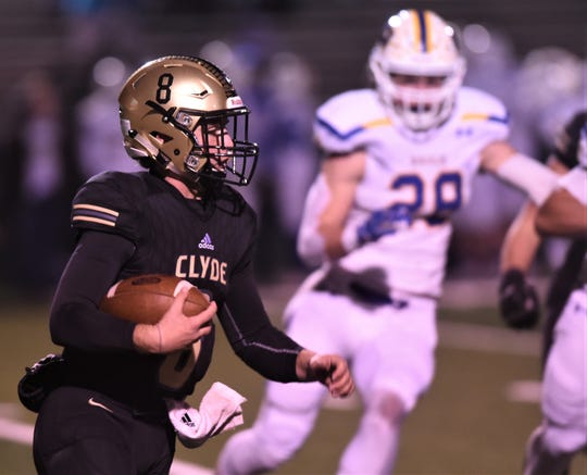 Clyde quarterback Dylan Neuman (8) looks for running room against Brock during the first half. Brock won the Region I-3A Division I bi-district playoff game 24-0 on Thursday, Nov. 14, 2019, at Shotwell Stadium.