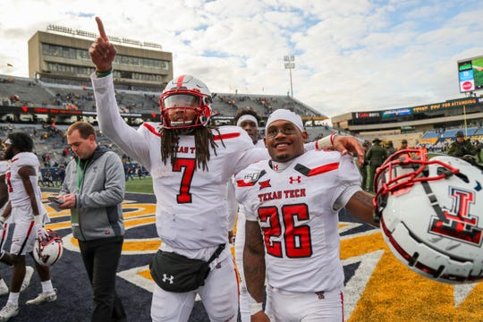 Nov 9, 2019; Morgantown, WV, USA; Texas Tech Red Raiders quarterback Jett Duffey (7) and running back Ta'Zhawn Henry (26) celebrate with fans after defeating the West Virginia Mountaineers at Mountaineer Field at Milan Puskar Stadium. Mandatory Credit: Ben Queen-USA TODAY Sports