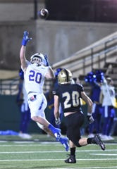 Brock's Luke Dillingham, left, leaps to make a catch while Clyde's Britten Brashear gives chase in the first half. Brock won the Region I-3A Division I bi-district playoff game 24-0 on Thursday, Nov. 14, 2019, at Shotwell Stadium.