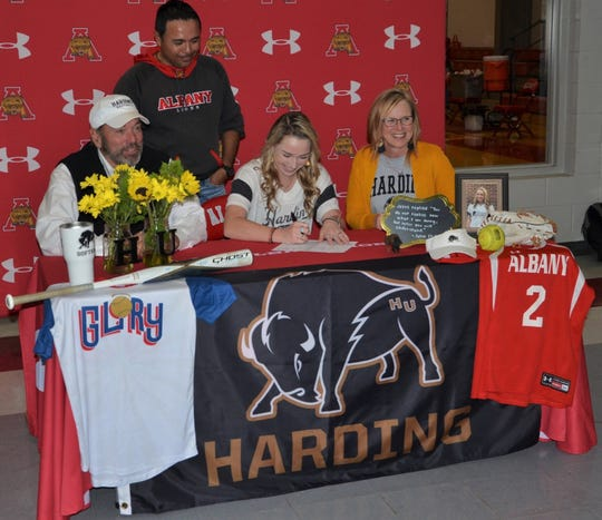 Albany senior Aubrey Moon signs her letter of intent to Harding University in Searcy, Arkansas at a ceremony Thursday afternoon at Albany High School.