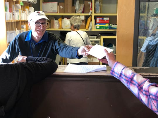 "David Johnson volunteers at Homeward Bound's AHOPE day shelter sorting and delivering mail. ""In order to get a job, they have to have an ID,"" Johnson said, noting that the homeless can use the AHOPE address to receive critical mail, including documents and identification."