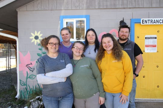 The Madison County Animal Services staff setup and broke down a temporary animal shelter in under a month to house 51 dogs seized from a home in the Spring Creek community. (Front row: Eden Payne, Nora Marler, Alex Griffin; back row: Angela Davis, Jessica Jenkins, and Stephen Rector. Not pictured: Christopher Payne)
