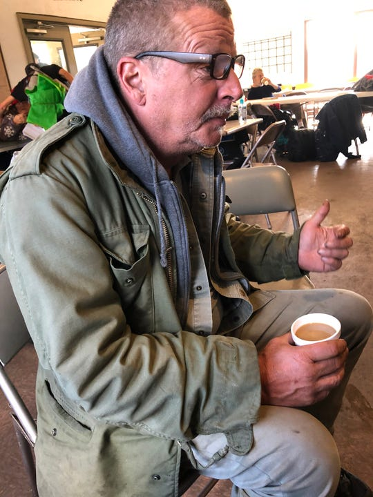 "James Warren considers himself ""chronically homeless"" and doesn't like staying in shelters because they have too many rules and separate him from his fiancee. He was enjoying hot coffee and some food last week at the AHOPE day shelter."