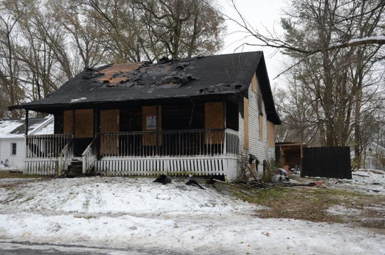 Fire heavily damaged the house at 105 Frisbie Ave.