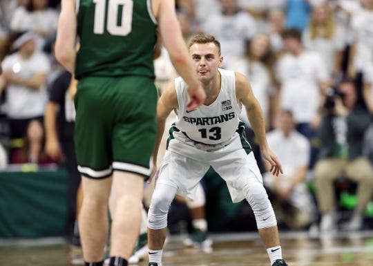 Nov 10, 2019; East Lansing, MI, USA; Binghamton Bearcats guard Leo Gallagher (10) is defend by Michigan State Spartans guard Steven Izzo (13) during the second half of a game at Breslin Center. Mandatory Credit: Mike Carter-USA TODAY Sports