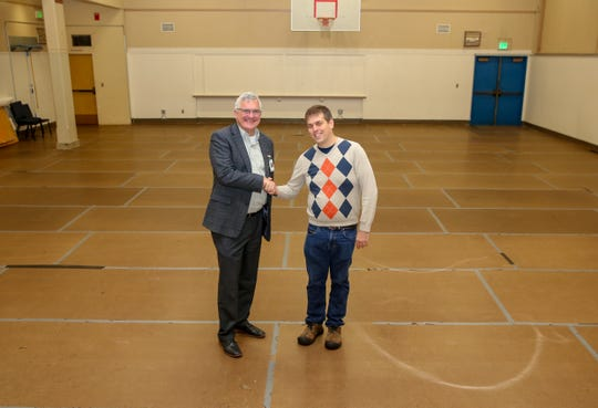 Doug Newell,Central Kitsap School District's executive director of business and operations, and Shawn Cupples of the nonprofit Sk8town Stars celebrate an agreement approved Nov. 13, 2019, for the group to lease the Jenne-Wright gym for skating groups and fundraisers.