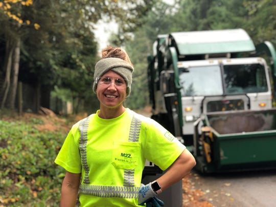 Waste Management driver Taylor Krause, a Navy veteran, on her route in South Kitsap.