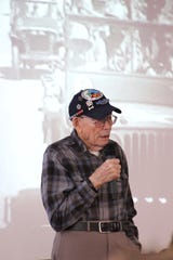 Earl Snypes talks to Owen High School students on Nov. 14 about his experience in the Eastern Theater during World War II.